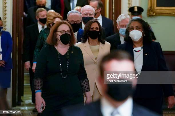 Members of Congress and Vice President Kamala Harris make their way to President Joe Bidens address of the Joint Session of the 117th Congress on the...