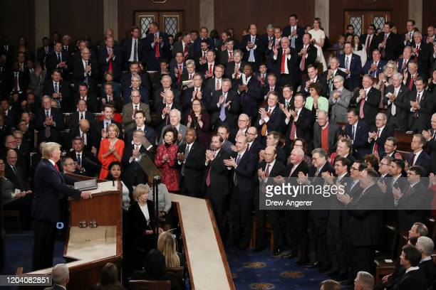 Members of Congress applaud as President Donald Trump delivers the State of the Union address House Speaker Rep. Nancy Pelosi and Vice President Mike...