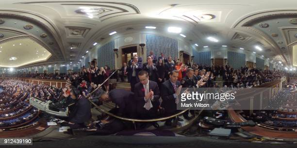 Members of Congress applaud as US President Donald J Trump delivers the State of the Union address in the chamber of the US House of Representatives...