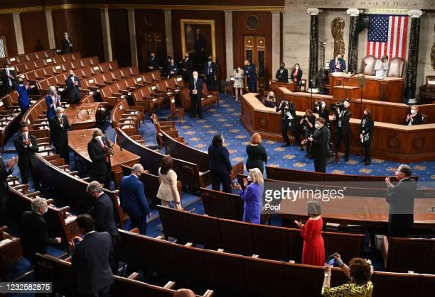 Members of Congress applaud as U.S. Vice President Kamala Harris arrives ahead of U.S. President Joe Biden addressing a joint session of Congress in...