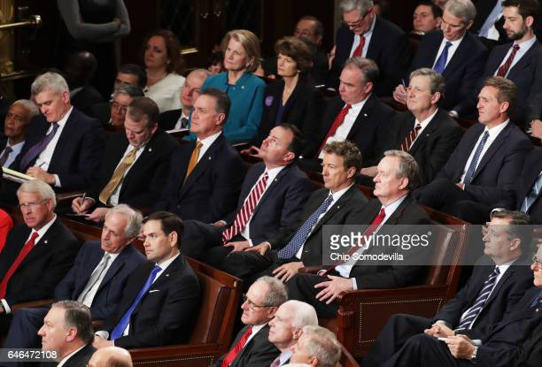 Members of congress attend US President Donald Trump's address to a joint session of the US Congress on February 28 2017 in the House chamber of the...