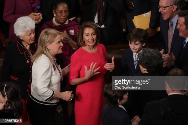 Members of Congress congratulate newly elected Speaker of the House Nancy Pelosi during the first session of the 116th Congress at the US Capitol...