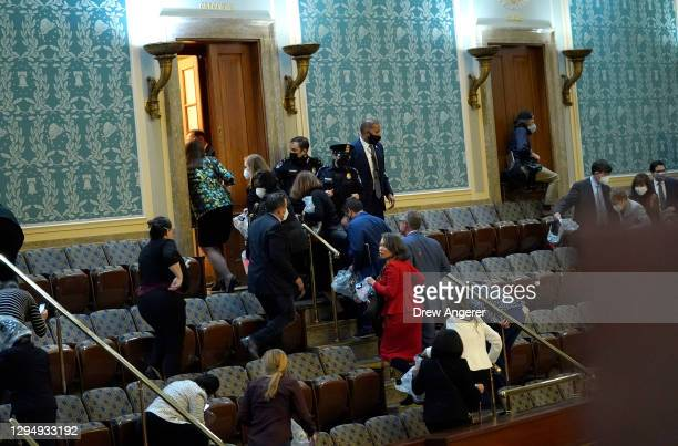 Members of Congress evacuate the House Chamber as protesters attempt to enter during a joint session of Congress on January 06, 2021 in Washington,...