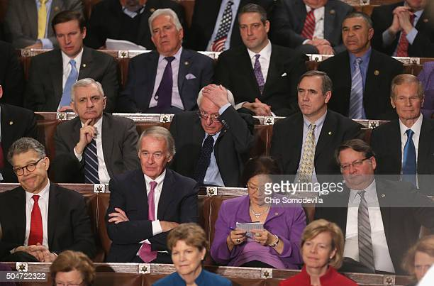 Members of congress including Democratic presidential candidate and US Sen Bernie Sanders listens to US President Barack Obama deliver the State of...