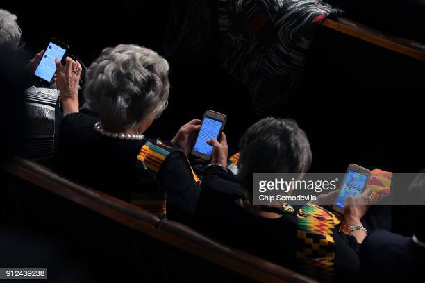 Members of Congress look at thier cell phones during the State of the Union address in the chamber of the US House of Representatives January 30 2018...