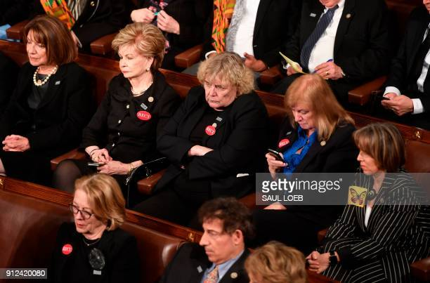 Members of Congress look on as US President Donald Trump delivers the State of the Union address at the US Capitol in Washington DC on January 30...