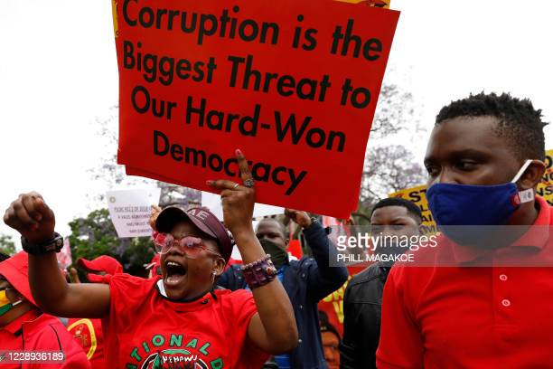 Members of Congress of South African Trade Unions react while marching to the National Treasury during their national strike against corruption and...