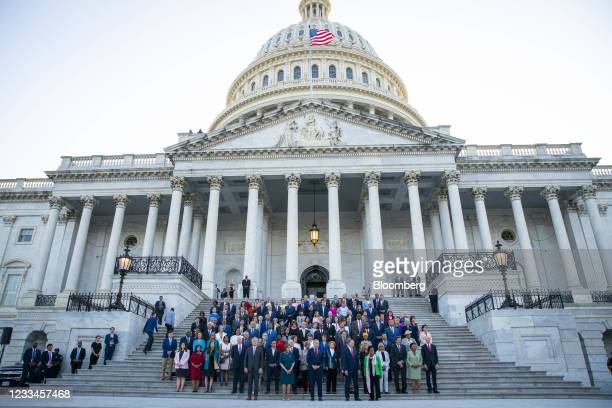 Members of congress participate in a moment of silence on the steps of the U.S. Capitol in Washington, D.C., U.S., on Monday, June 14, 2021....