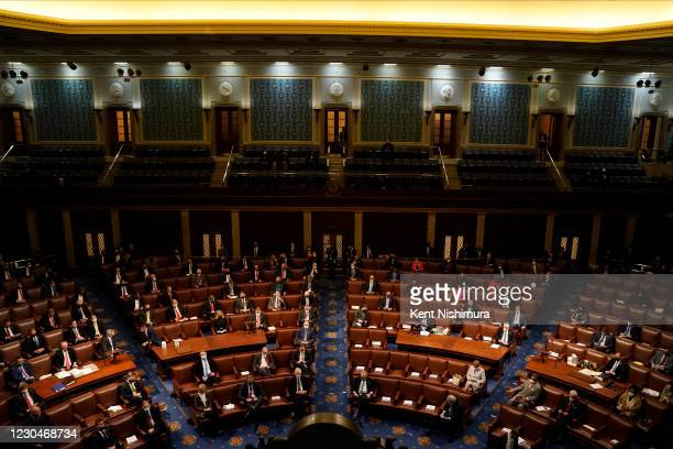 Members of congress sit in the chamber during a joint session of the 117th Congress in the House Chamber of the U.S. Capitol where all the Electoral...