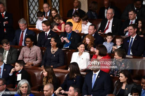 Members of Congress smile after voting during the 116th Congress and swearingin ceremony on the floor of the US House of Representatives at the US...