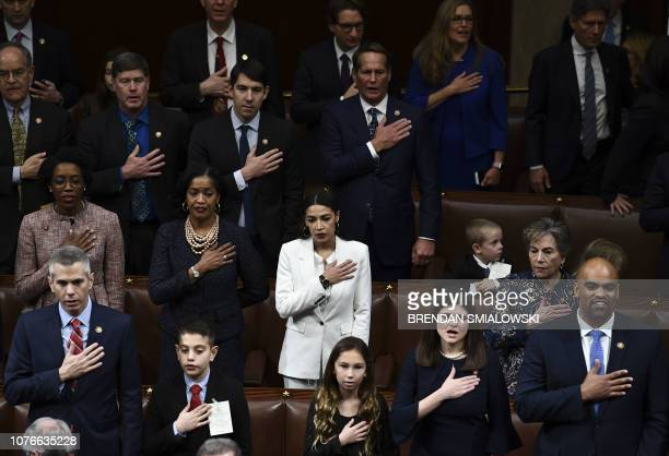 Members of Congress take the oath during the start of the 116th Congress and swearingin ceremony on the floor of the US House of Representatives at...