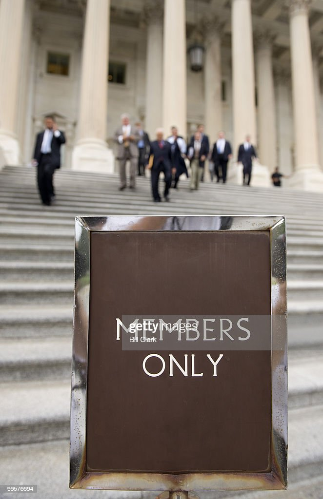 Members of Congress walk down the East Steps of the Capitol following a series of votes on Thursday, July 31, 2008. The House of Representatives hoped to wrap up business later in the night and begin their August break on Friday.