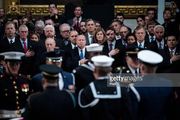 Members of Congress watch as the casket containing the remains of former US President George HW Bush is carried in by military honor guard to the US...
