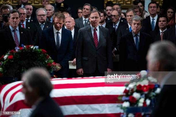 Members of Congress watch as the casket containing the remains of former US President George HW Bush lies in state in the US Capitol Rotunda on...