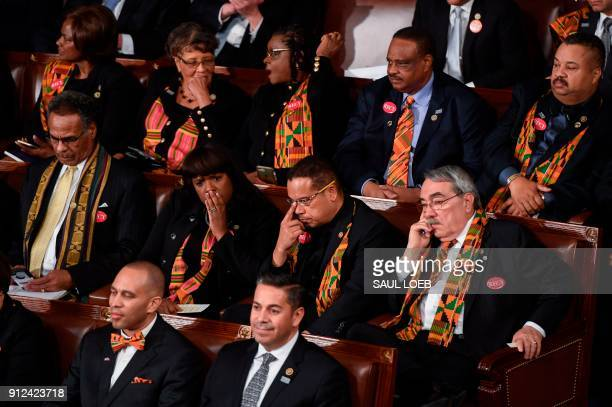 Members of Congress wear black clothing and Kente cloth in protest as US President Donald Trump delivers the State of the Union address at the US...