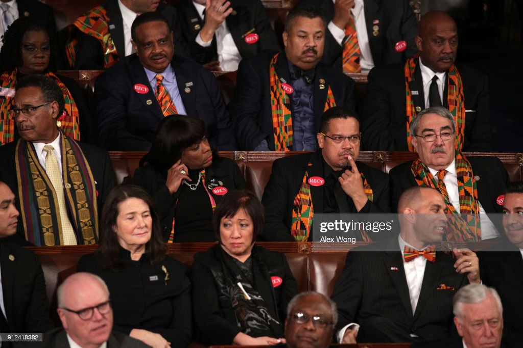 Members of Congress wear black clothing and Kente cloth in protest during the State of the Union address in the chamber of the U.S. House of Representatives January 30, 2018 in Washington, DC. This is the first State of the Union address given by U.S. President Donald Trump and his second joint-session address to Congress.