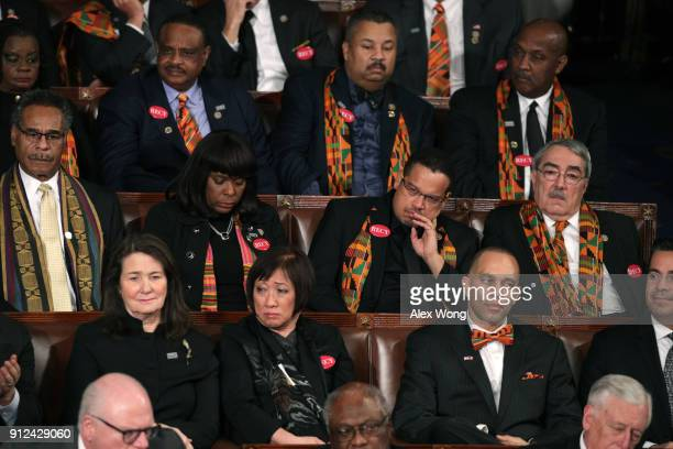 Members of Congress wear black clothing and Kente cloth in protest before the State of the Union address in the chamber of the US House of...