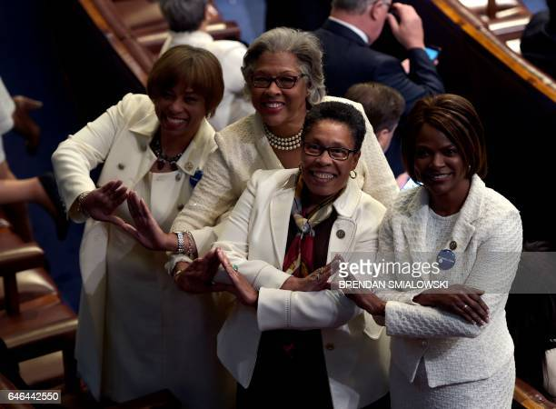 Members of congress wear white to honor the women's suffrage movement and support women's rights before US President Donald Trump addresses a joint...