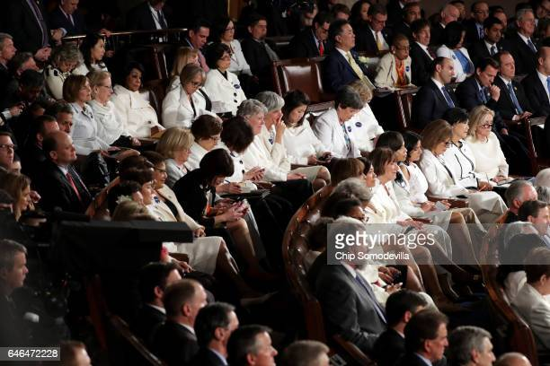 Members of congress wear white to honor the women's suffrage movement and support women's rights as US President Donald Trump addresses a joint...
