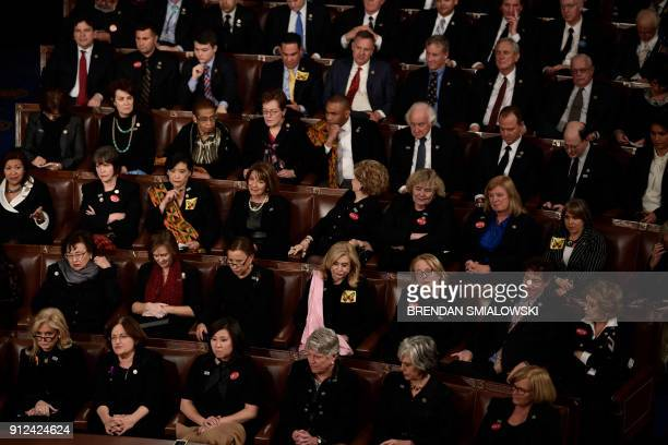 Members of Congress wearing black outifts in solidarity with the #MeToo and #TimesUP movements listen as US President Donald Trump delivers the State...