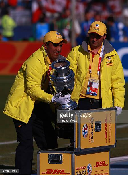 Members of Conmebol take out the Copa America trophy from a security box prior the 2015 Copa America Chile Final match between Chile and Argentina at...