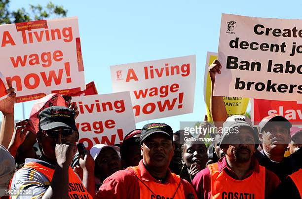 Members of COSATU and other trade unions hold a protest march on March 7 2012 in Cape Town South Africa The unions embarked on a nationwide strike...