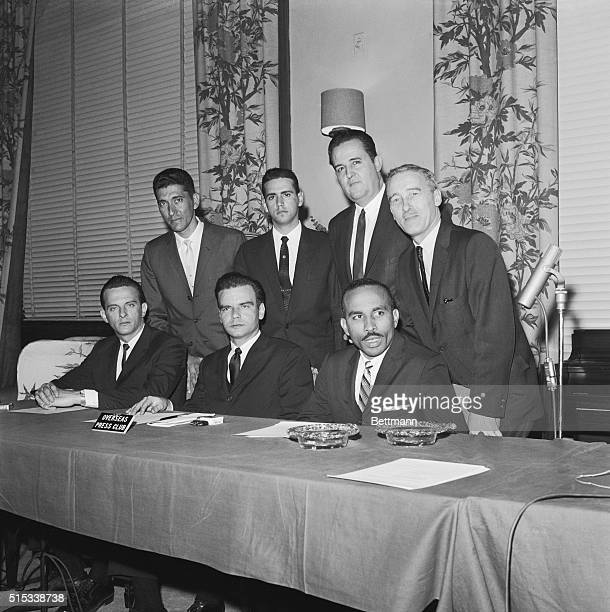 Members of Cuban Invasion Brigade 2506 get together during news conference at the Overseas Press Club here January 18 Seated left to right are Jose...