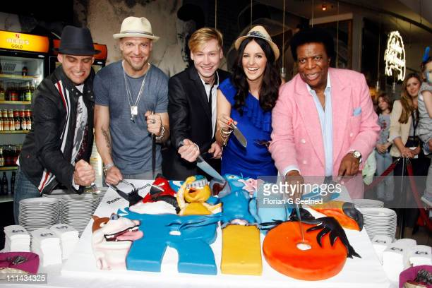 Members of Culcha Candela, Itchy and Reedoo, actor David Kross, actress Johanna Klum and singer Roberto Blanco attend the German Premiere of 'RIO' at...