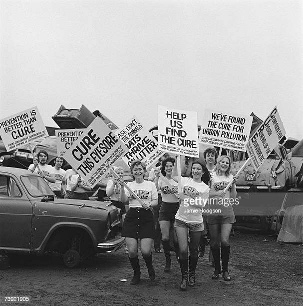 Members of CURE the Young Conservative Campaign for the Urban Renewal of the Environment stage a protest at a scrap heap 15th January 1972