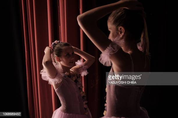 Members of Dance Centre Kenya make their final checks in the stage wing during a production of the 'Nutcracker' a ballet primarily performed during...