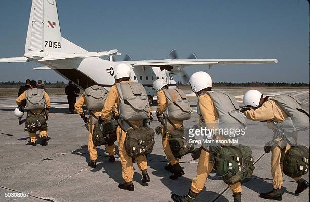 Members of Delta Force Special Operations preparing to conduct HALO training which involves parachuting at an altitude which requires oxygen and...