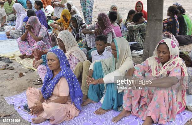 Members Of Dera Sacha Sauda arrive for the support of Dera Chief Sant Gurmeet Ram Rahim Singh as the hearing of Sadhavi rape and murder case will be...