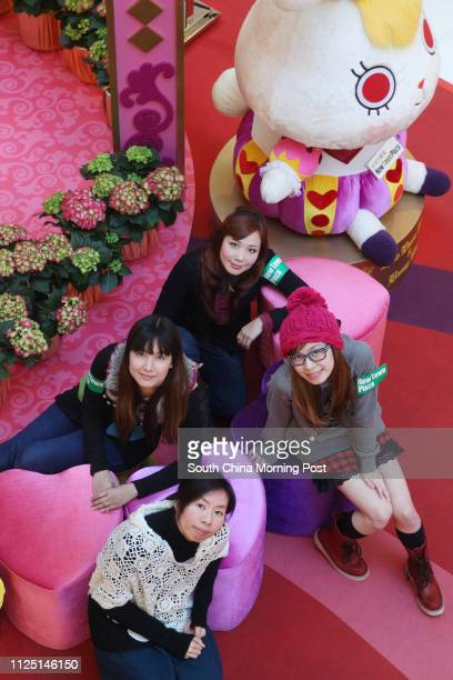 Members of design team Dream Capsule Ching Chau Doris Ma Elaine Tang and Joyce Ho pose with their cartoon Bunny King exhibition at New Town Plaza Sha...