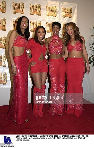 Members of Destiny's Child pose for photos backstage at The 14th Annual Soul Train Music Awards March 4 2000 in Los Angeles Ca