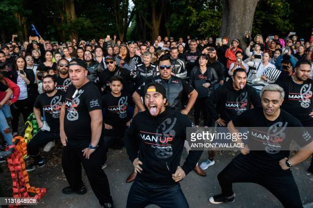 TOPSHOT Members of different biker gangs perform the haka as a tribute to victims in Christchurch on March 20 five days after the twin mosque...