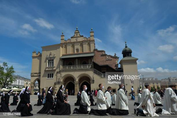 Members of different catholic religious orders seen during a Corpus Christi procession led by Archbishop Marek Jedraszewski in Krakow's Main Market...