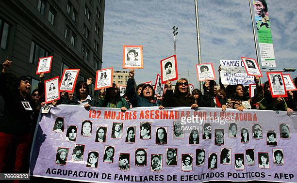Members of different Human Rights organizations pay tribute to late Chilean President Salvador Allende in the surroundings of La Moneda presidential...