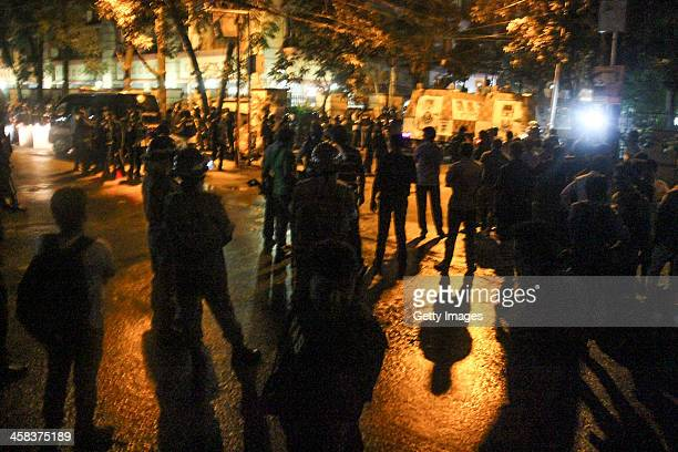 Members of different security agencies of Bangladesh gather alongside the meida on July 01 2016 in Dhaka Bangladesh Last night gunmen raided a cafe...