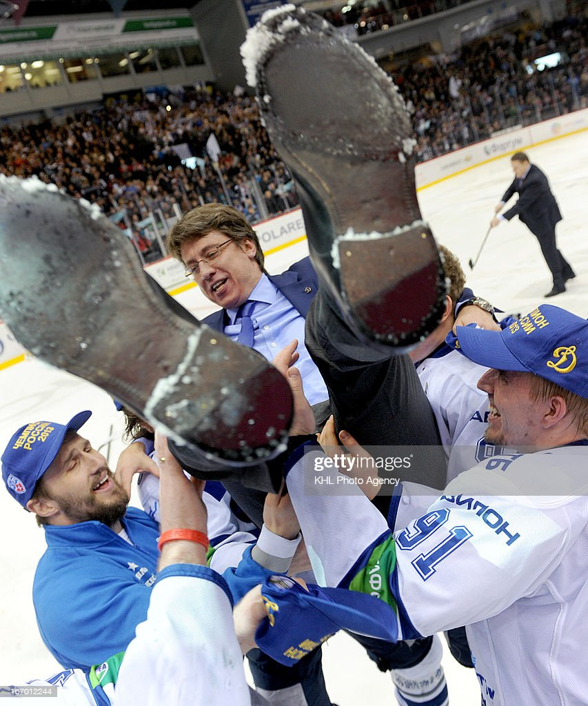 Members of Dinamo celebrate with coach Harijs Vitolins after Dinamo Moscow defeats Traktor Chelyabinsk at the final play-off game during the KHL Championship 2012/2013 on April 18, 2013 at the Arena Traktor in Chelyabinsk, Russia.