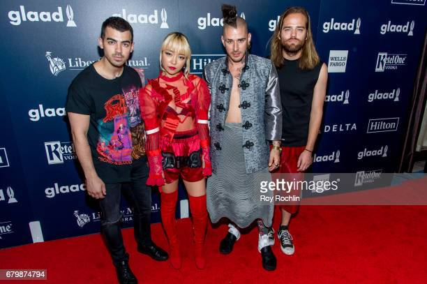 Members of DNCE Joe Jonas JinJoo Lee Cole Whittle and Jack Lawless attends the 28th Annual GLAAD Awards at New York Hilton Midtown on May 6 2017 in...