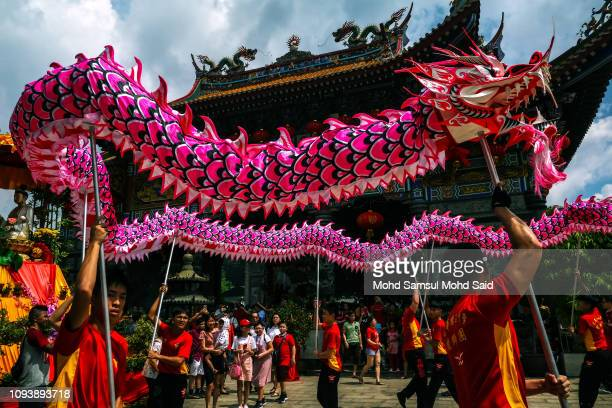 Members of dragon dance perform a traditional dance inside the Kuan Yin temple during Lunar New Year celebrations on February 5 2019 in Klang outside...