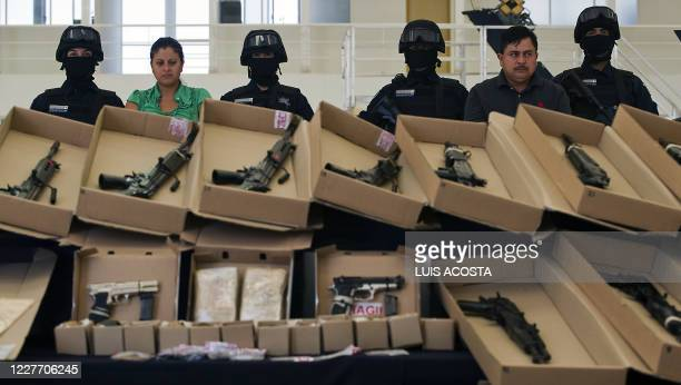"Members of drug gang ""Los Zetas"" Margarito Mendoza and Carmen Zuniga are shown to the press in Mexico City on October 22, 2010. During their arrest,..."