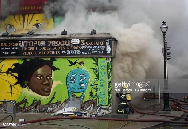 Members of Dublin Fire Brigade tackle a blaze at the Nirvana head shop on Capel Street Dublin