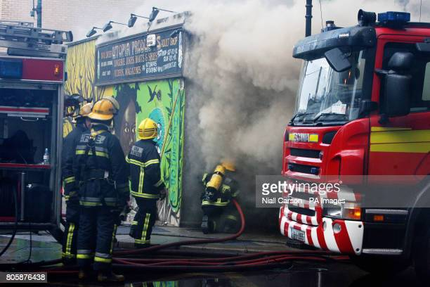 Members of Dublin Fire Brigade tackle a blaze at the Nirvana head shop on Capel Street Dublin