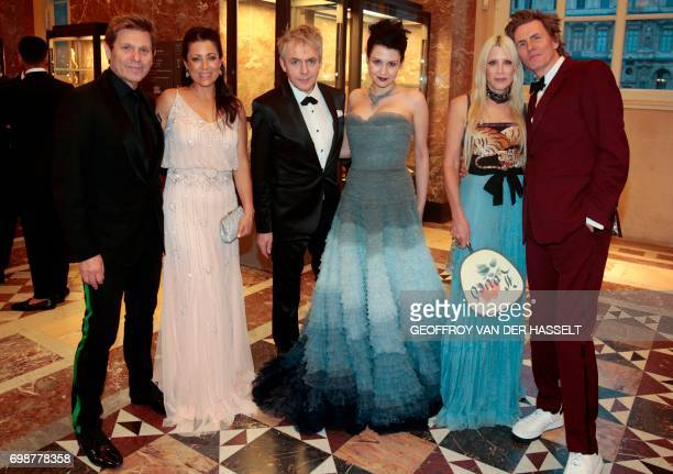 Members of Duran Duran rock band Roger Taylor and his wife Gisella Bernales Nick Rhodes and his partner Nefer Suvio John Taylor and his wife Gela...