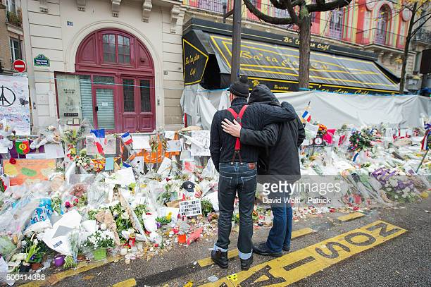 Members of Eagles of Death Metal visit a memorial that pays homage to the victims of the terrorist attacks at Le Bataclan on December 8 2015 in Paris...