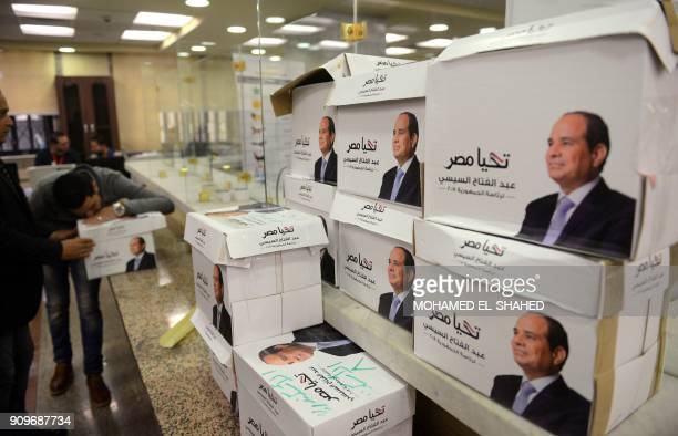 Members of Egyptian President Abdel Fattah alSisi's presidential campaign staff stand next to boxes containing signatures in his support needed to...