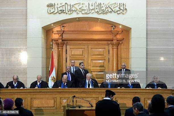 Members of Egypt's constitutional court hold a session to rule on the law organising the upcoming parliamentary elections on March 1 2015 in the...