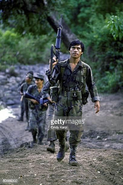 Members of El Salvadoran Army's special unit Cutzcatlan patrolling during sweep against leftist guerrillas