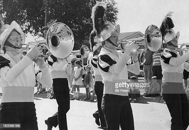 PARADE Members of Eldoradan Drum and Bugle Corps of Colorado march in Littleton